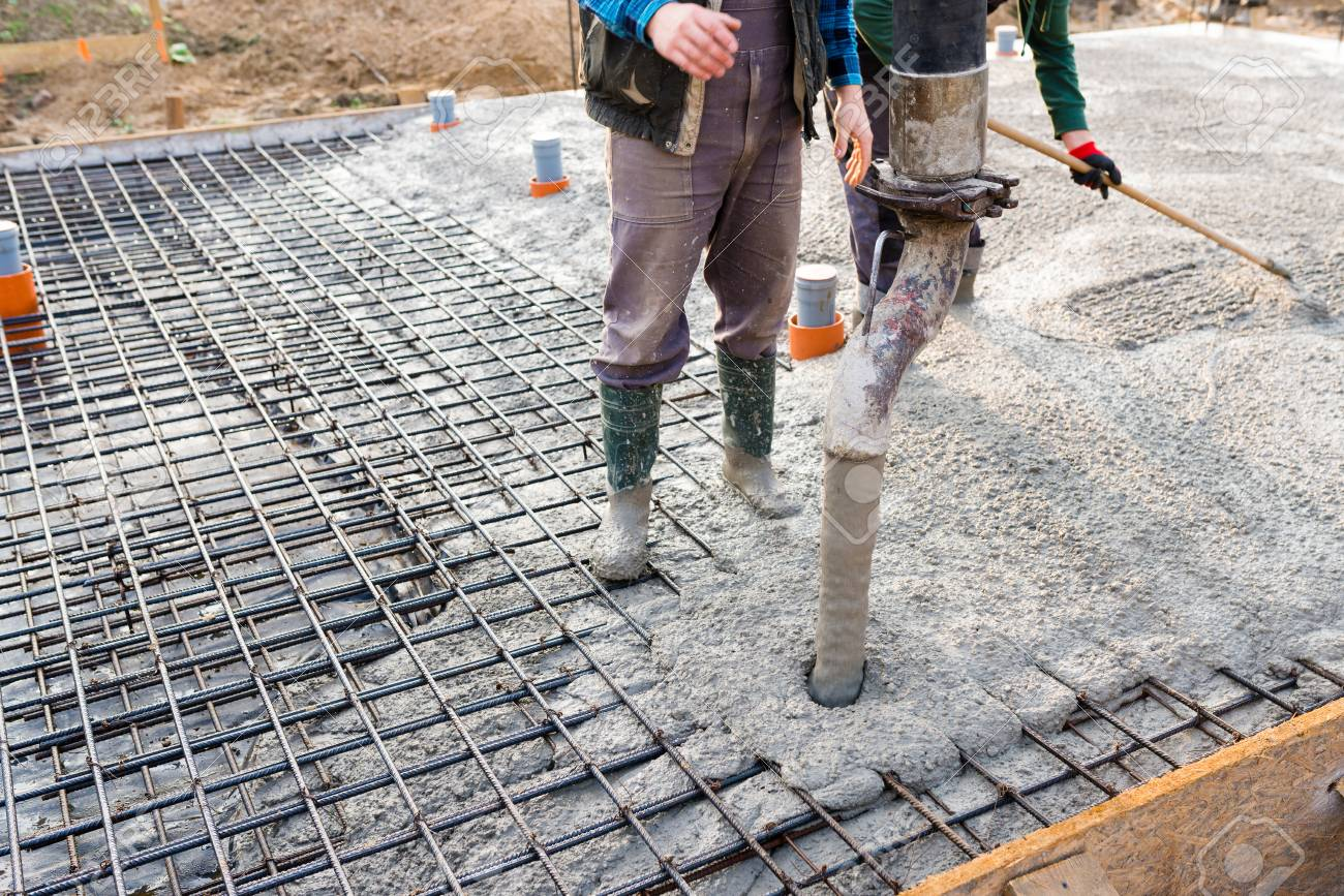 pouring concrete slab - concrete pouring during commercial concreting floors of buildings in construction